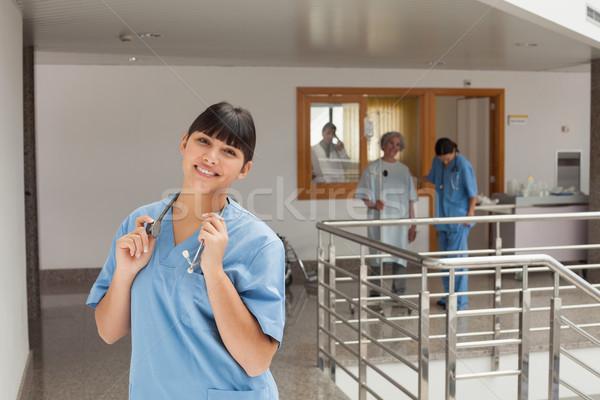 śmiechem lekarza stałego korytarzu dotknąć stetoskop Zdjęcia stock © wavebreak_media