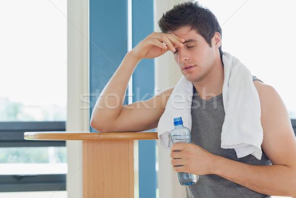 Férfi elvesz törik edz tornaterem arc Stock fotó © wavebreak_media
