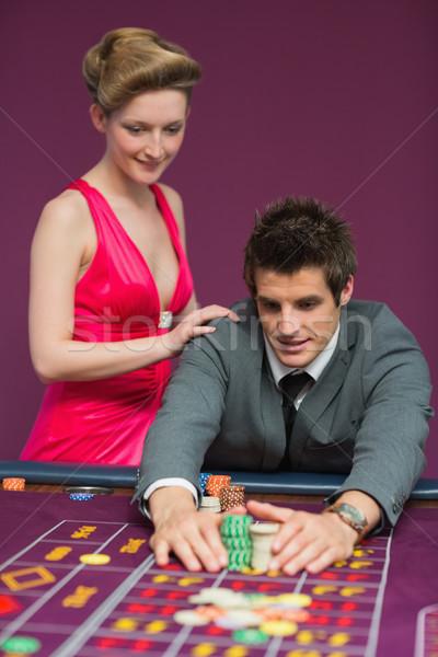 Man taking his winnings at the roulette table  Stock photo © wavebreak_media
