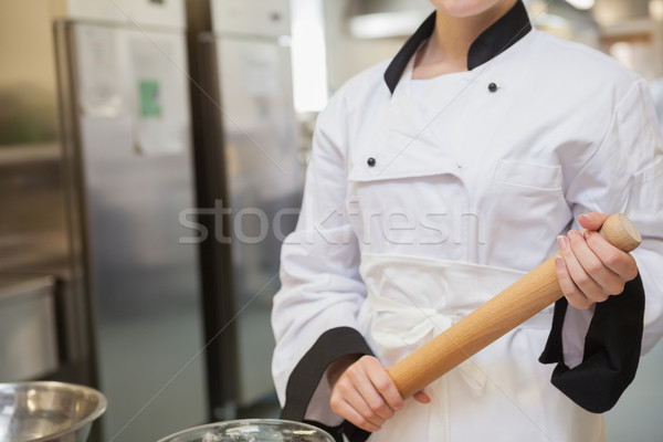 Baker with rolling pin in kitchen Stock photo © wavebreak_media
