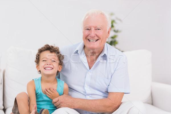 Derűs nagyapa unoka ül kanapé ház Stock fotó © wavebreak_media