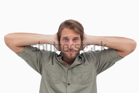 Stock photo: Man blocking his ears and closing his eyes