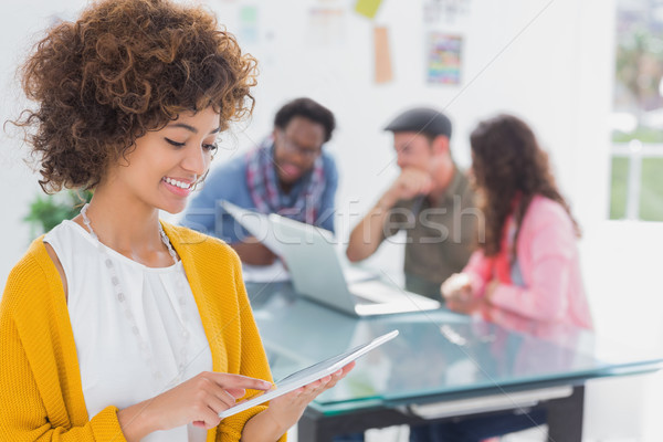 Stock photo: Editor using tablet and smiling