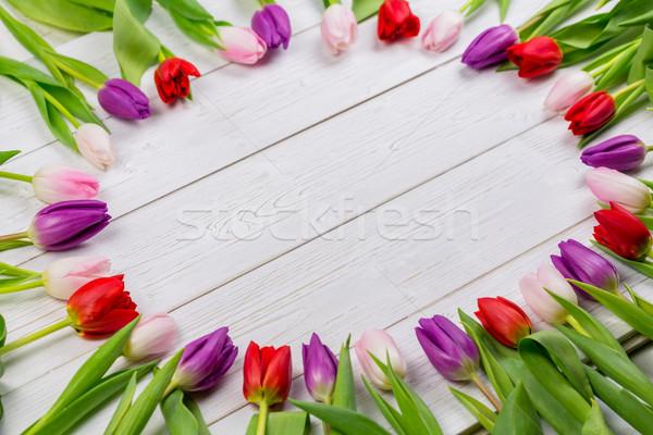 Tulipani frame tavolo in legno tavola verde foglie Foto d'archivio © wavebreak_media