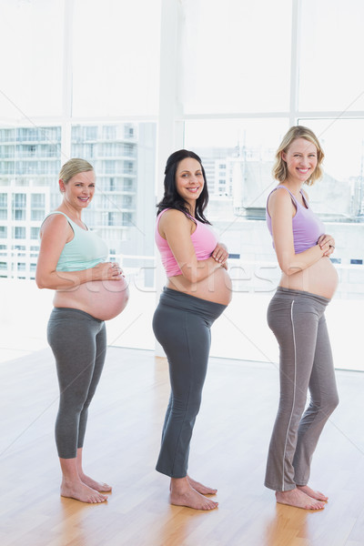 Boldog terhes nők áll vonal mosolyog Stock fotó © wavebreak_media