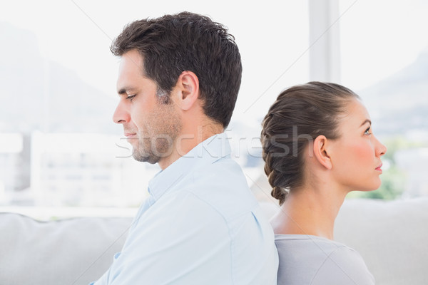 Unhappy couple sitting back-to-back on the couch Stock photo © wavebreak_media
