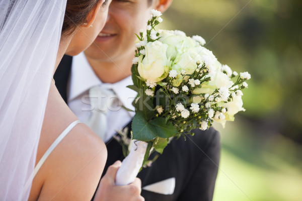 Mid section of a newlywed couple with bouquet in park Stock photo © wavebreak_media