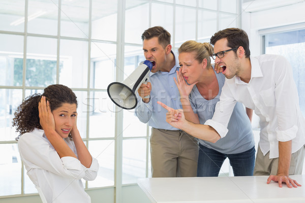 Casual business team shouting at a colleague Stock photo © wavebreak_media