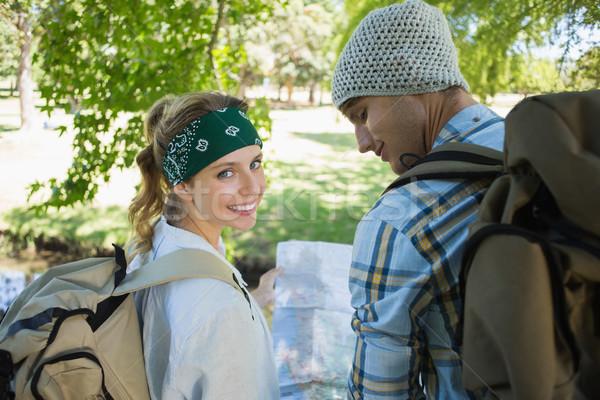 Aktív mosolyog pár túrázik tanácsadás térkép Stock fotó © wavebreak_media