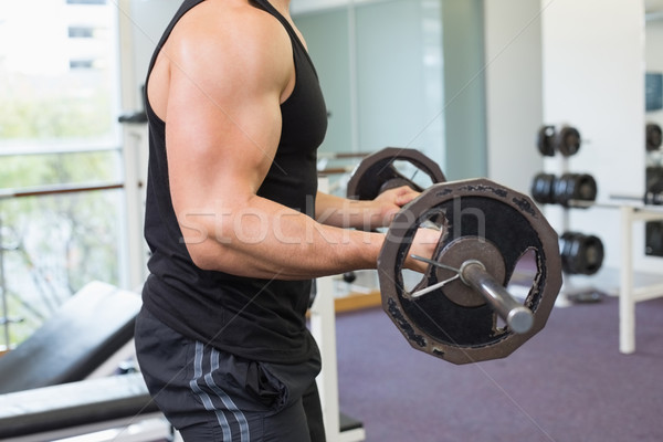 Muscular musculação pesado preto barbell Foto stock © wavebreak_media