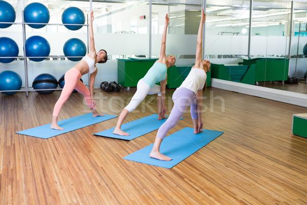 Yoga class in fitness studio Stock photo © wavebreak_media