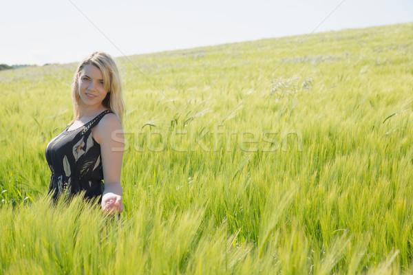 Pretty blonde in sundress standing in wheat field Stock photo © wavebreak_media