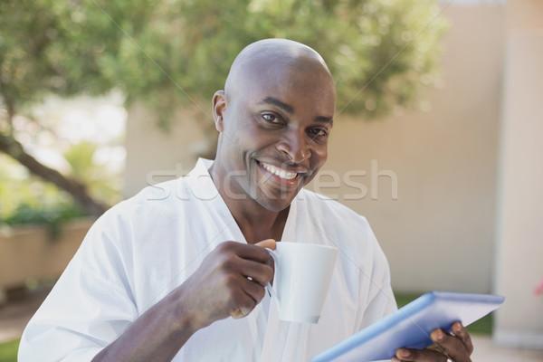 Yakışıklı adam bornoz tablet kahvaltı dışında Stok fotoğraf © wavebreak_media