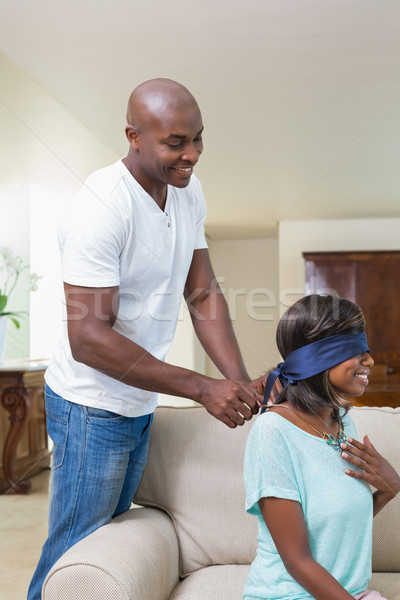 Man surprising his girlfriend with a necklace on the couch Stock photo © wavebreak_media