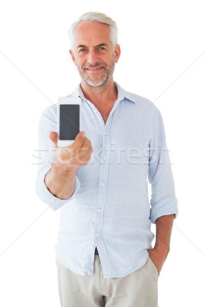 Mosolyog férfi mutat okostelefon kamerába fehér Stock fotó © wavebreak_media
