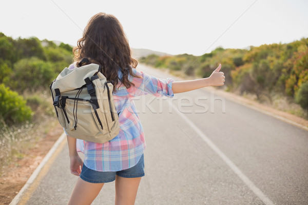 Woman hitchhiking on countryside road Stock photo © wavebreak_media