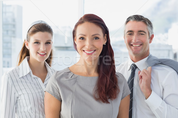 Smiling business woman with colleagues  Stock photo © wavebreak_media