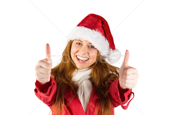 Stock photo: Festive redhead showing thumbs up