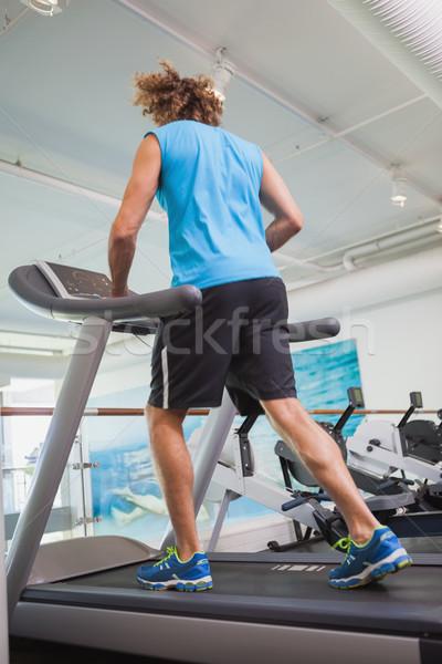 вид сзади человека работает бегущая дорожка спортзал молодым человеком Сток-фото © wavebreak_media