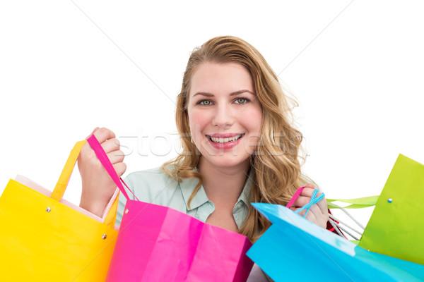 きれいな女性 笑みを浮かべて カメラ ショッピングバッグ 白 幸せ ストックフォト © wavebreak_media