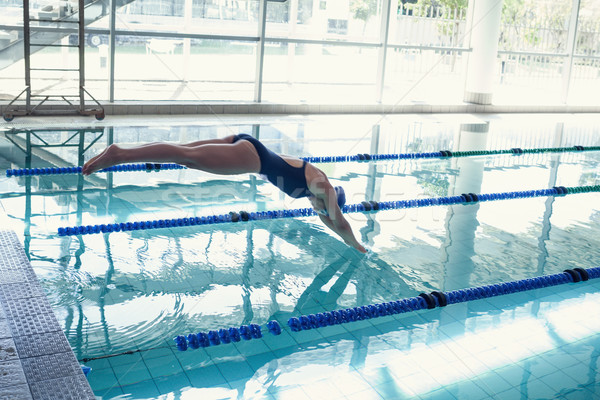 Side view of swimmer diving into pool at leisure center Stock photo © wavebreak_media