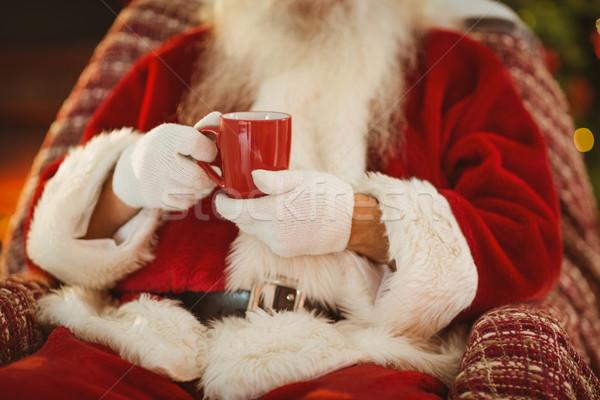 Święty mikołaj gorący napój domu salon Zdjęcia stock © wavebreak_media