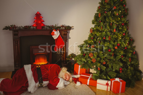Santa claus sleeping on the rug Stock photo © wavebreak_media