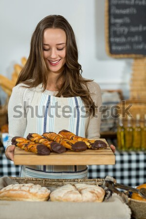 Happy brunette holding her roast turkey Stock photo © wavebreak_media