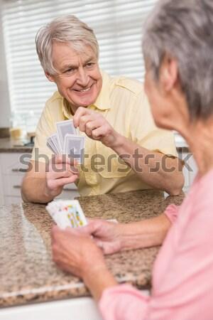 Starszy para karty do gry Licznik domu kuchnia kobieta Zdjęcia stock © wavebreak_media