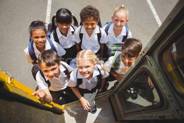 Foto stock: Cute · autobús · escolar · fuera · escuela · primaria · nina
