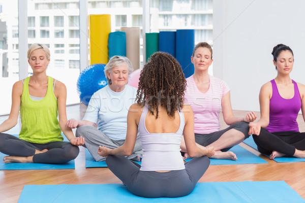 People practicing lotus position in yoga class Stock photo © wavebreak_media