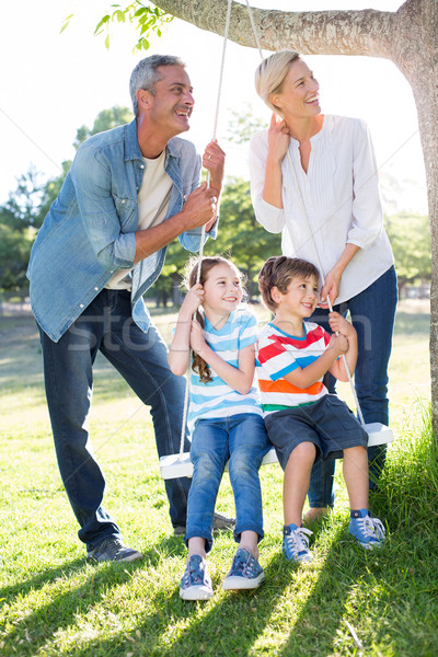 Família feliz balançar mulher árvore feliz Foto stock © wavebreak_media