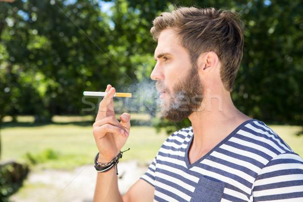 Hipster smoking electronic cigarette Stock photo © wavebreak_media