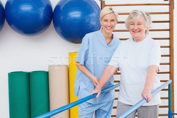 Senior woman and therapist smiling at camera  Stock photo © wavebreak_media