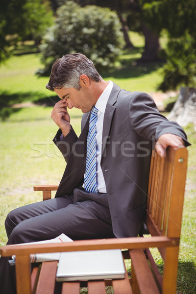 Businessman thinking in the park Stock photo © wavebreak_media