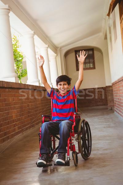 Chłopca wózek szkoły korytarz portret cute Zdjęcia stock © wavebreak_media