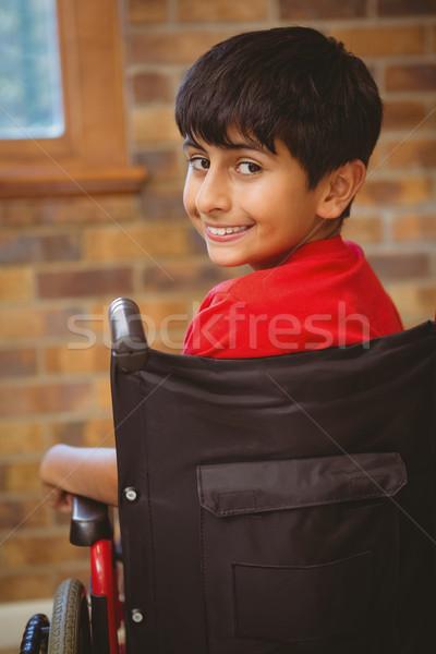 Menino sessão cadeira de rodas escolas retrato bonitinho Foto stock © wavebreak_media