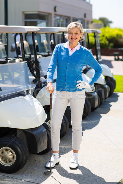 Female golfer beside golf buggy  Stock photo © wavebreak_media