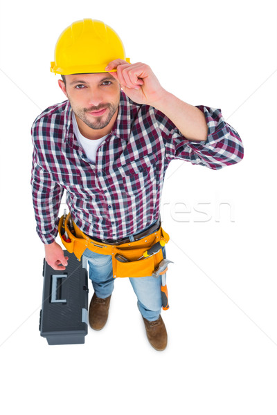 Smiling handyman with tool box  Stock photo © wavebreak_media