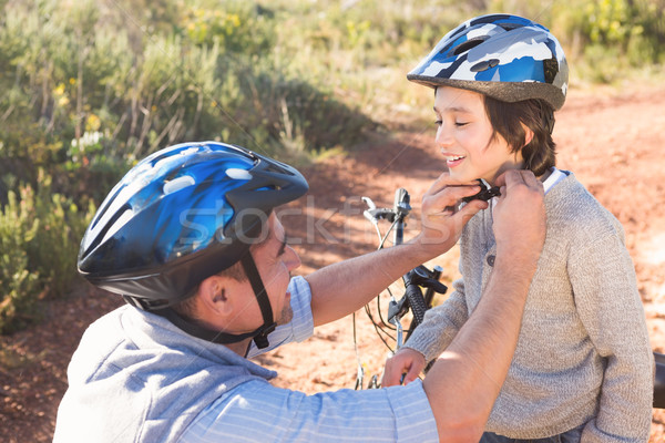 Father clipping on sons helmet  Stock photo © wavebreak_media