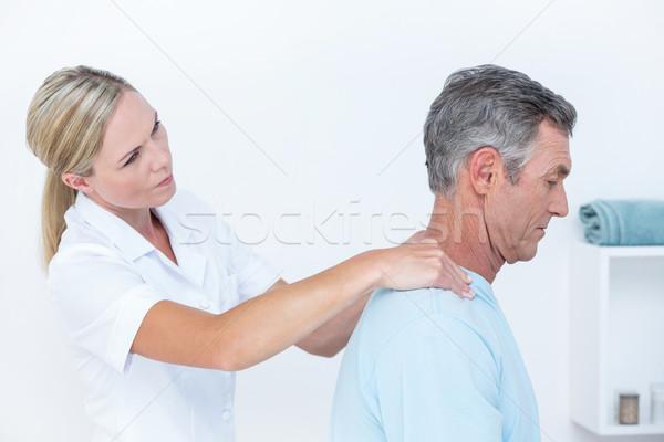 医師 ストレッチング 患者 首 医療 オフィス ストックフォト © wavebreak_media