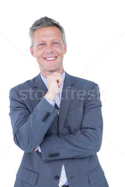 Biznesmen myślenia strony podbródek biały garnitur Zdjęcia stock © wavebreak_media