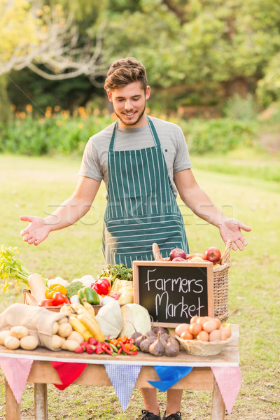 Stock photo: Handsome farmer standing at his stall