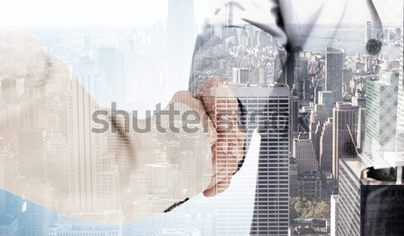 Composite image of mid section of man adjusting camera lens Stock photo © wavebreak_media