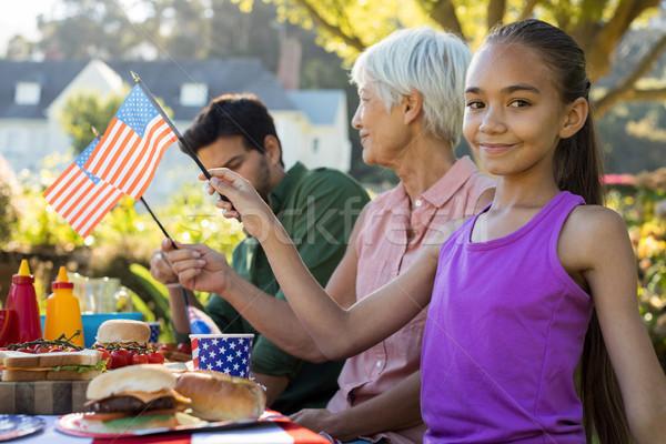 Lány tart amerikai zászló piknik asztal portré nő Stock fotó © wavebreak_media