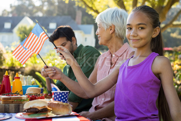 Meisje Amerikaanse vlag picknicktafel portret vrouw Stockfoto © wavebreak_media