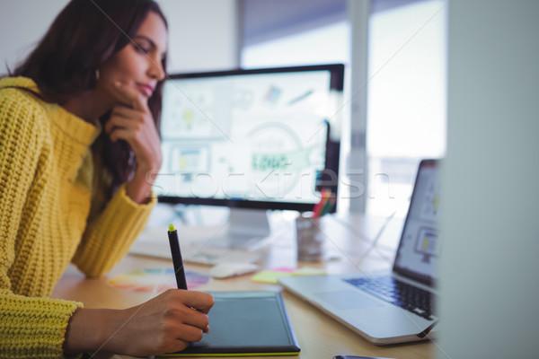 Female graphic designer using digitizer in office Stock photo © wavebreak_media
