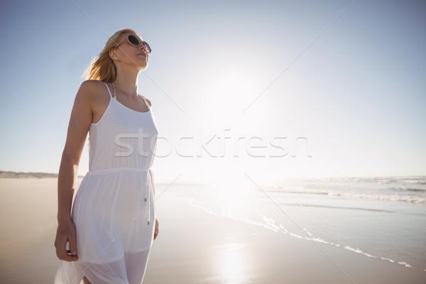 Stock photo: Woman wearing sunglasses on shore at beach