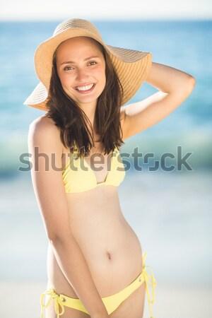 Portrait of smiling woman pouring cream on palm Stock photo © wavebreak_media