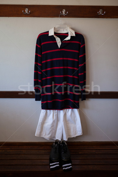 Rugby uniform hanging over shoes and socks on bench Stock photo © wavebreak_media